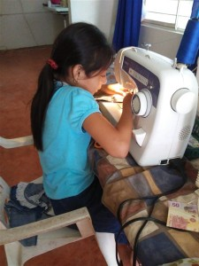 Little Ana is one of the youngest students in the sewing school.