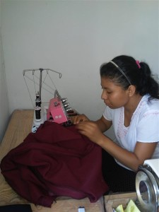 Alicia working in the sewing school/workshop. Alicia is one of the key teachers in this ministry school.