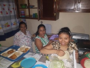 Women hard at work in new kitchen at the feeding center preparing food for the children.