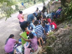 Distributing clothing and shoes to poor Pame villagers.
