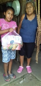 When it became impossible for the children to come to Cristina she went to them. This orphaned child (being raised by her great grandmother) receives a food care-package through the ministry of Hidden Manna.