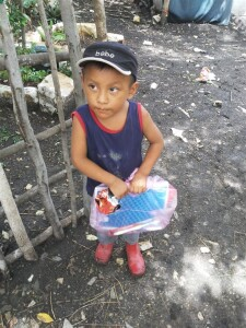 A happy little boy receives kindergarten supplies.