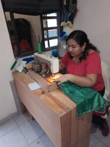 One of the women at the sewing school/workshop. This ministry has empowered so many women and girls.
