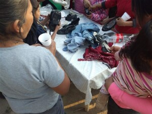 share clothing and footwear with some of the needy of the Pame